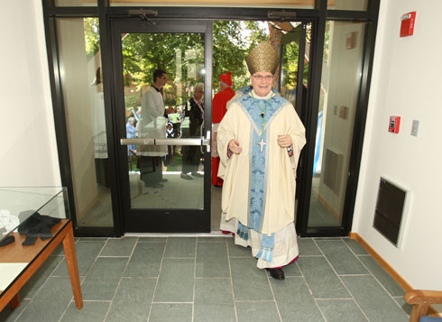 Archbishop Goulet Entering Visitor Center (Catholic Review Photo)