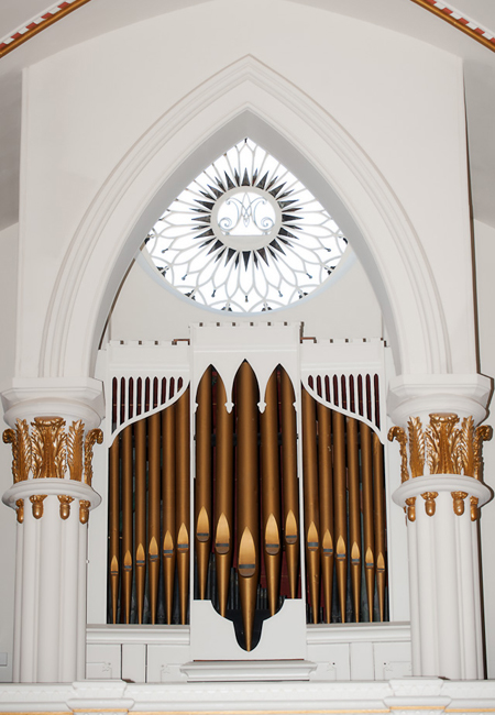 Pipe organ and rose window in chapel