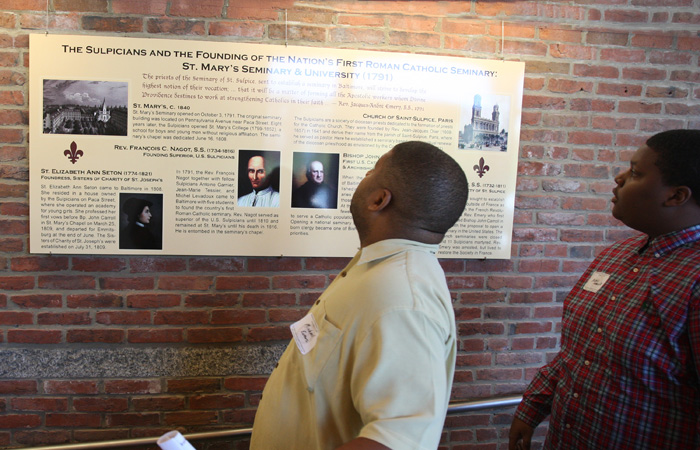 Visitors viewing story boards on the site's history